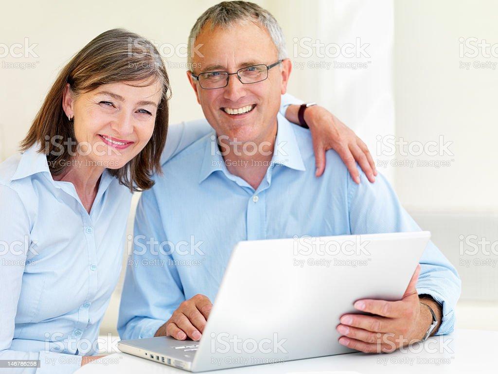 Close-up of a senior couple using laptop royalty-free stock photo