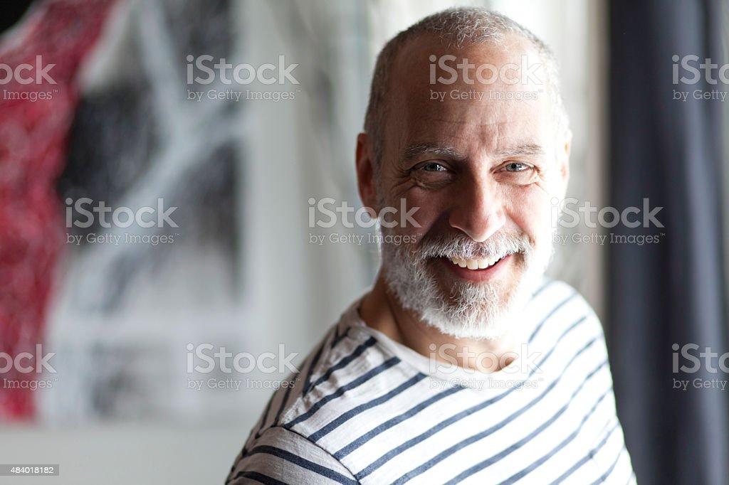 Closeup Of A Senior Man Smiling At The Camera stock photo