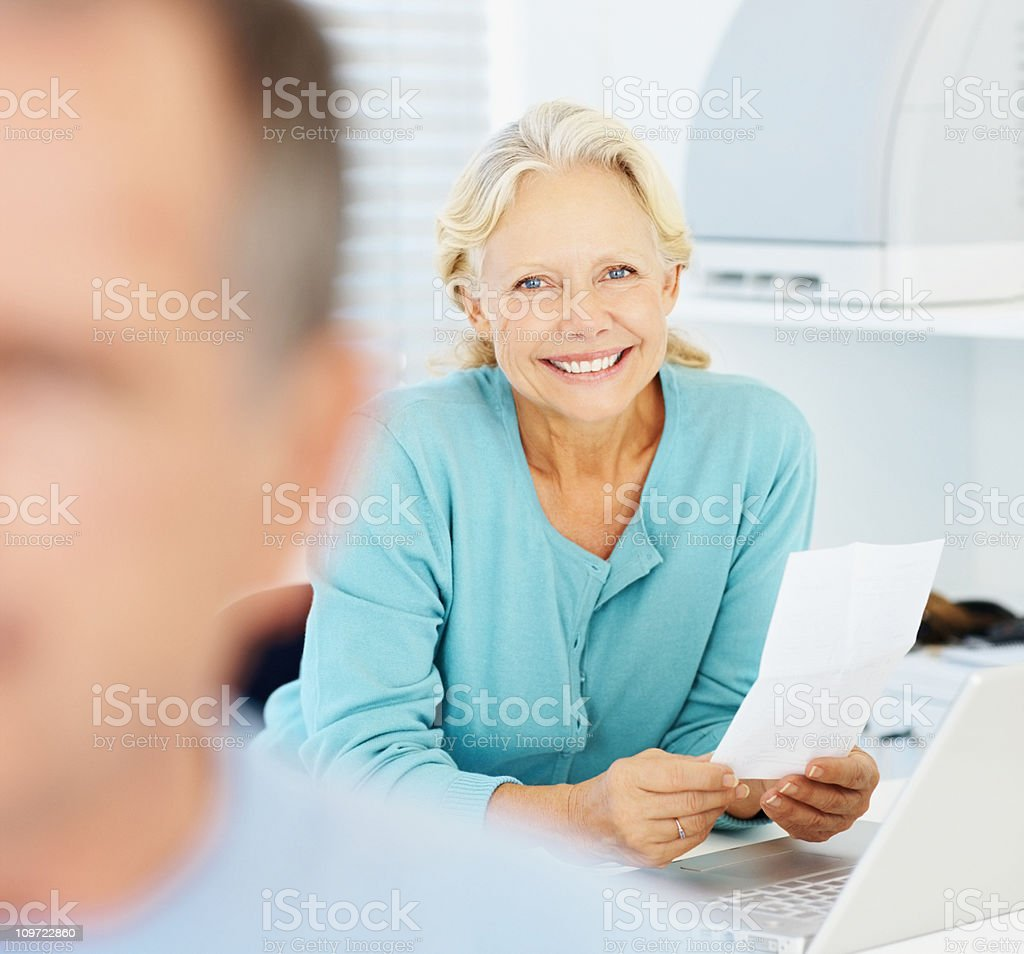 Closeup of a senior woman doing the bills royalty-free stock photo