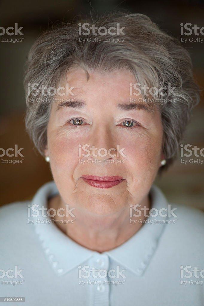 Close-up of a senior woman looking at the camera stock photo