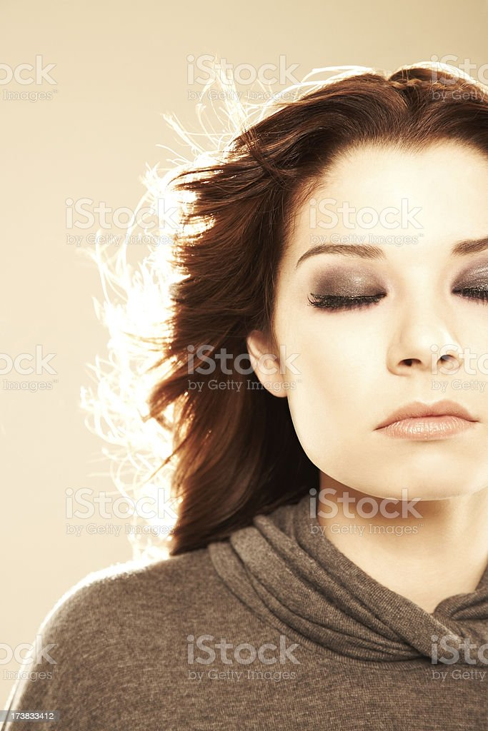 Close-up of a sensuous fashion model with looking relaxed royalty-free stock photo