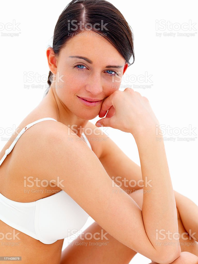 Closeup of a sexy attractive woman sitting in white bra isolated on white background stock photo