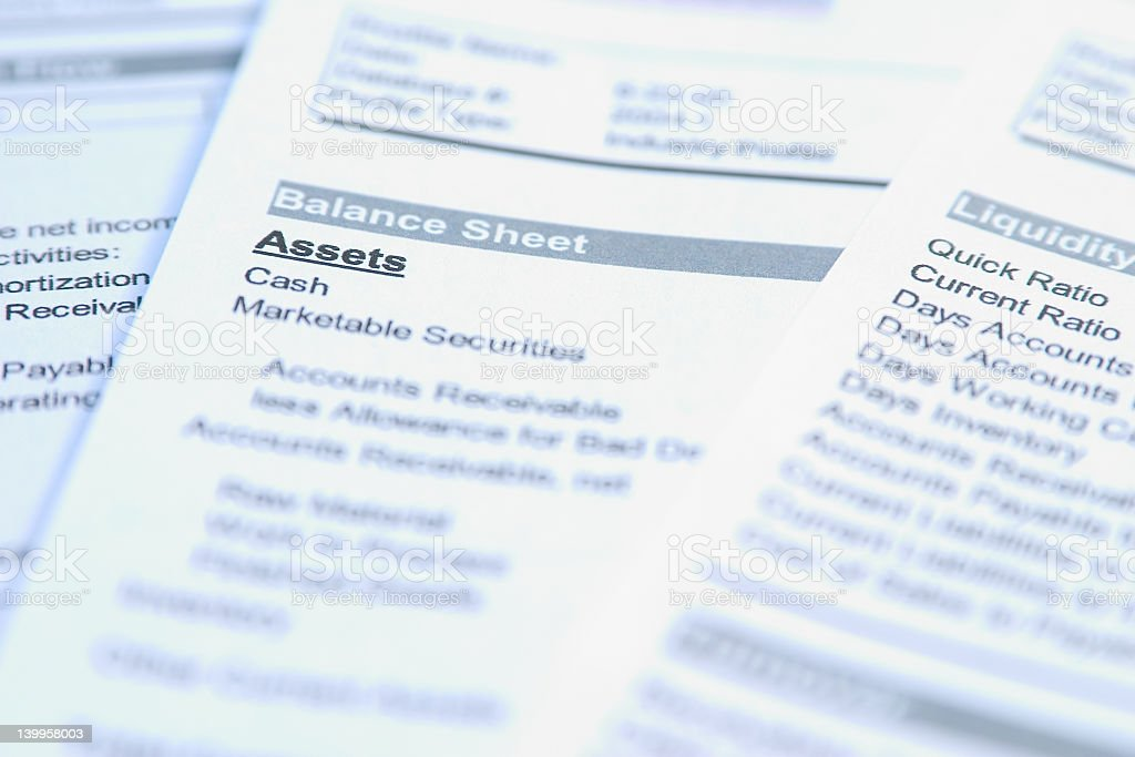 Closeup of a sheet of paper focusing on the word Assets  stock photo