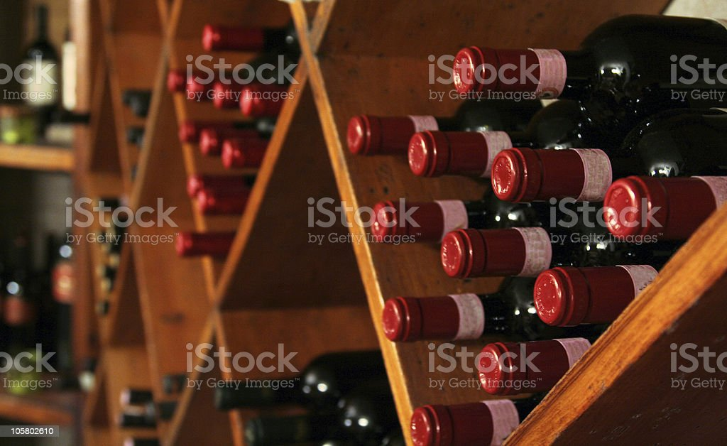 Close-up of a shelf with cubicles filled with wine bottles royalty-free stock photo