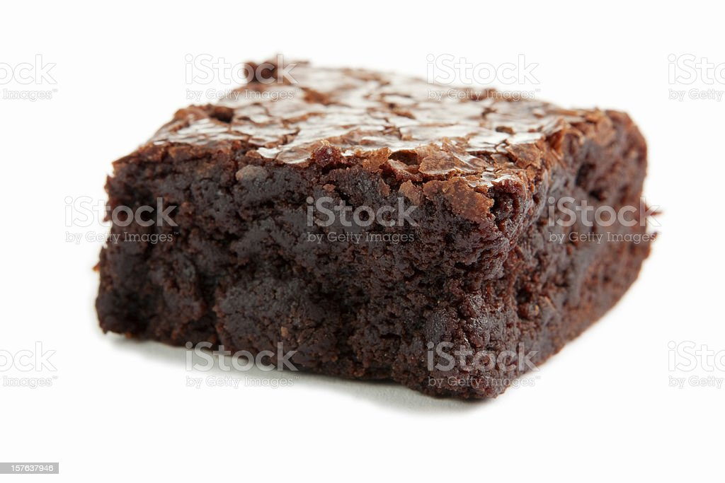 Close-up of a single chocolate brownie on a white surface royalty-free stock photo