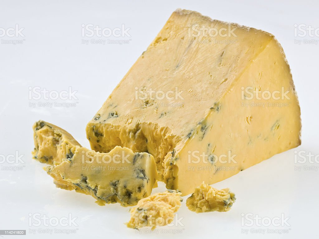 Closeup of a slice of blue cheese on white background. royalty-free stock photo