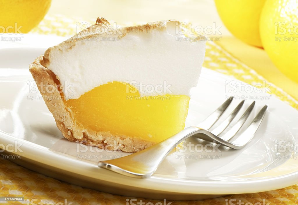 Close-up of a slice of lemon meringue pie stock photo