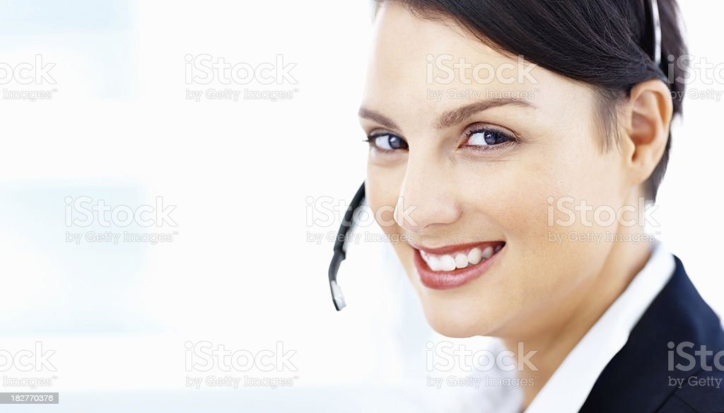 Close-up of a smiling business lady wearing headset royalty-free stock photo