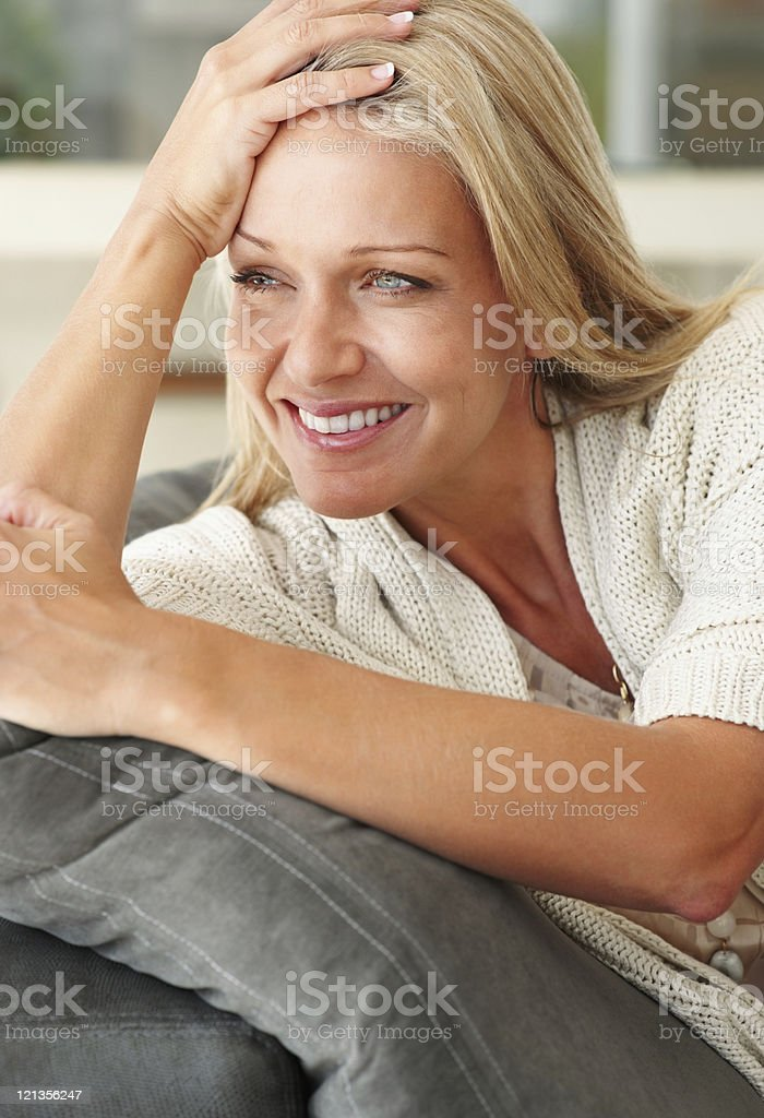 Closeup of a smiling pretty lady looking away royalty-free stock photo