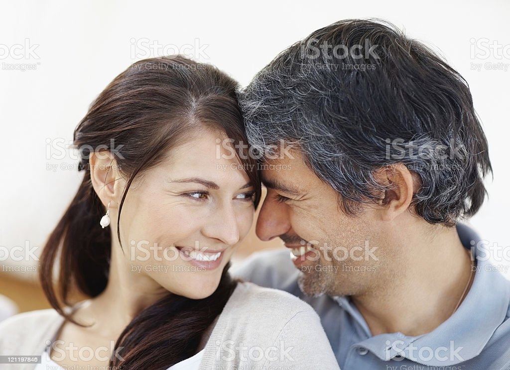 Closeup of a smiling romantic mid adult couple royalty-free stock photo