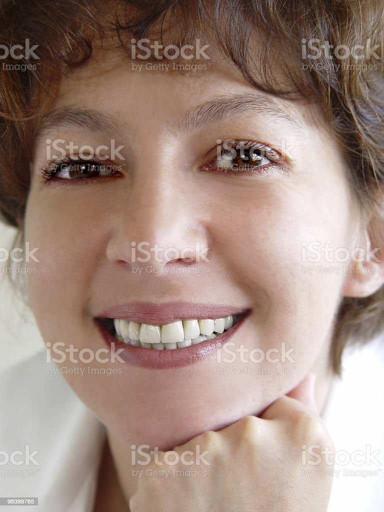 Closeup of a smiling woman royalty-free stock photo