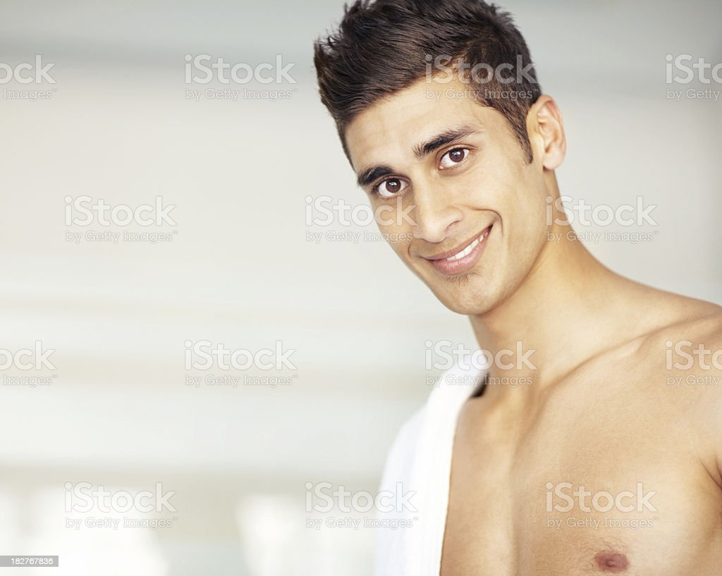 Close-up of a smiling young man looking at camera royalty-free stock photo