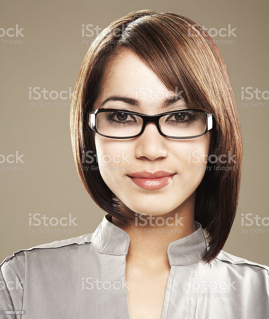 Close-up of a smiling young woman in spectacles stock photo