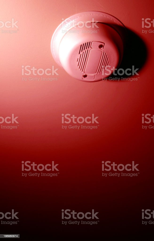 A close-up of a smoke detector on the ceiling royalty-free stock photo