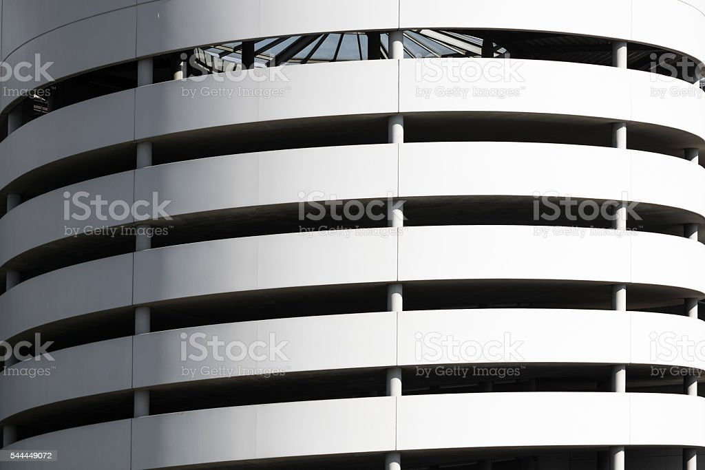 Closeup of a spiral driveway into a multi storey car park stock photo