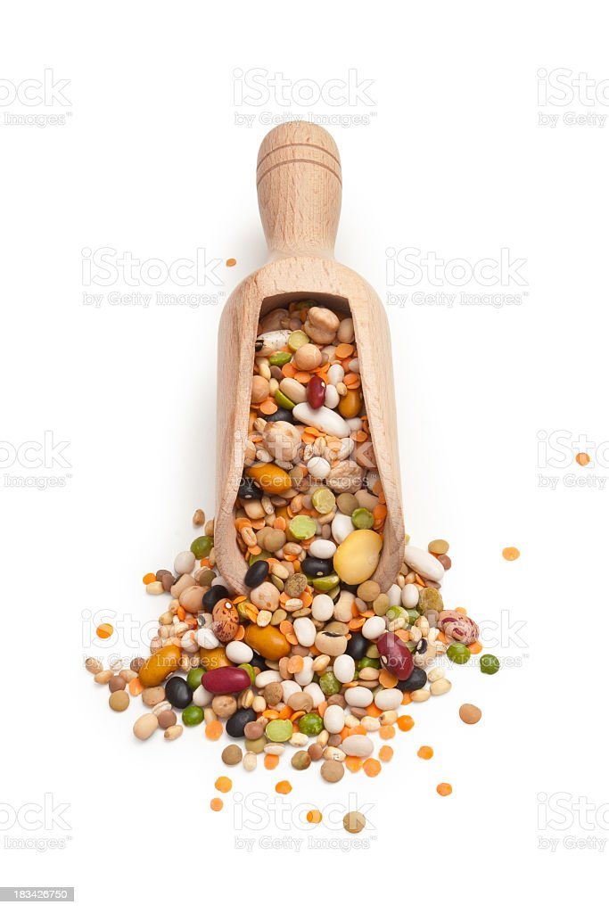 A close-up of a spoon full of legumes and cereals royalty-free stock photo