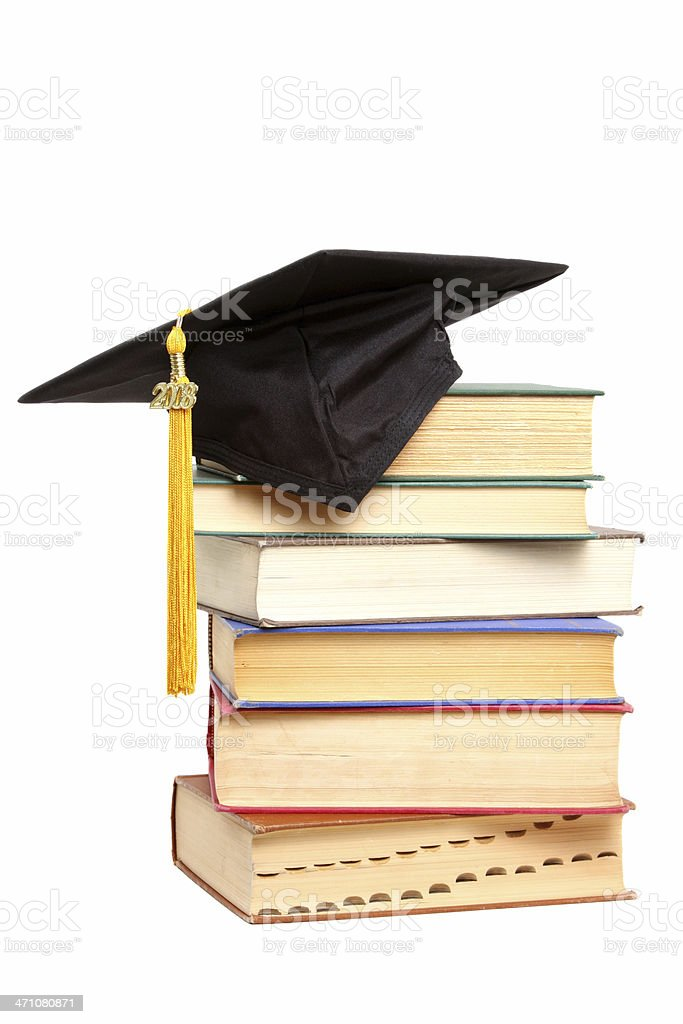 Close-up of a stack of books with a graduation cap atop it royalty-free stock photo