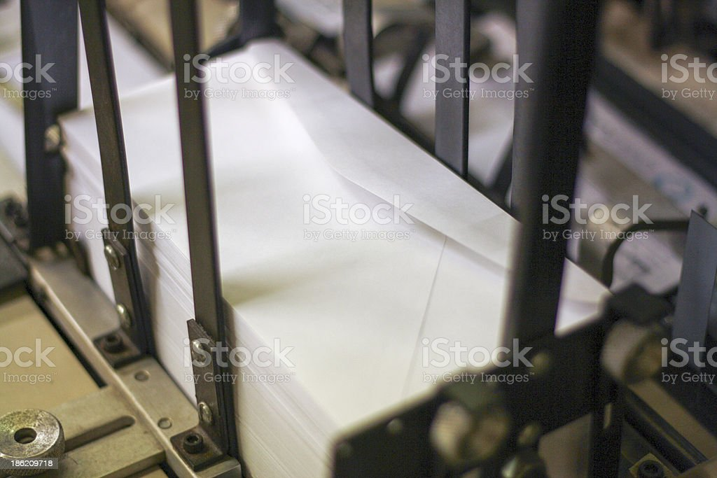 Close-up of a stack of envelops placed in metal feeder stock photo