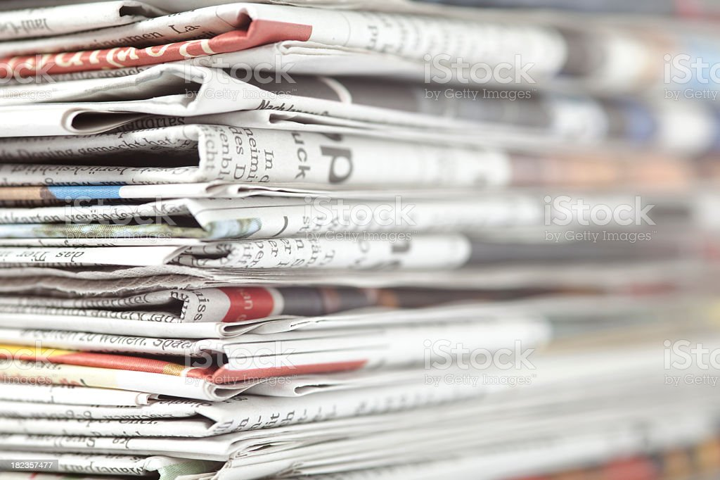 Close-up of a stack of newspapers stock photo