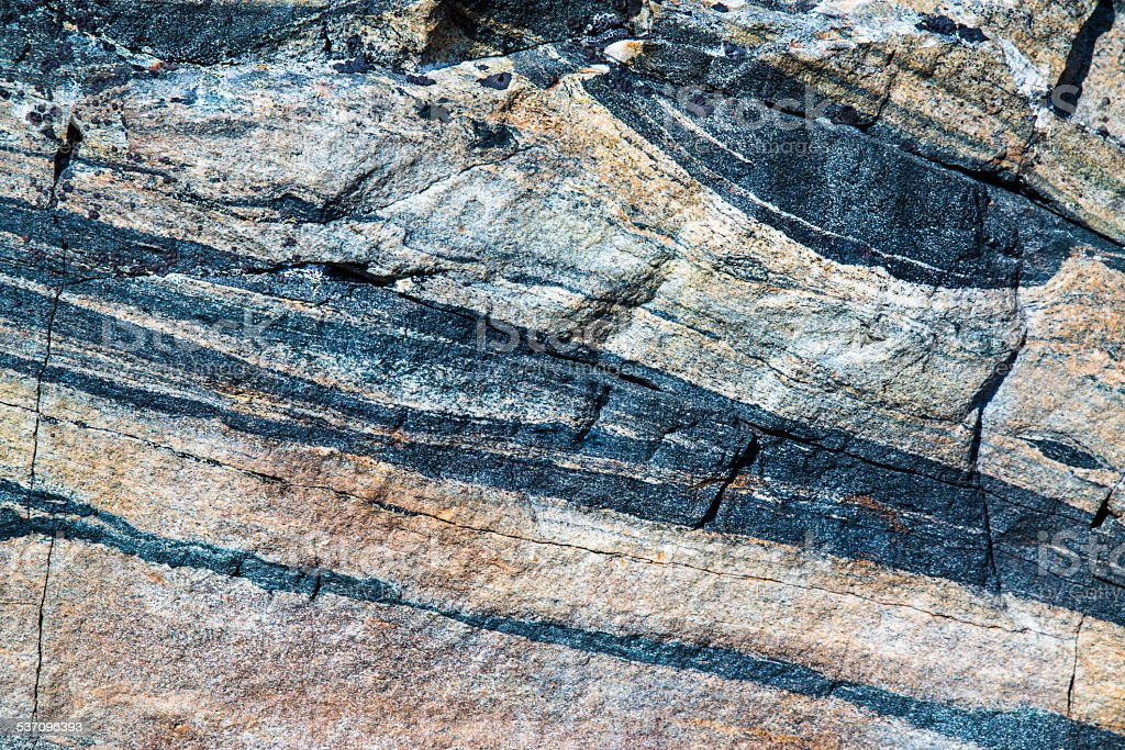 closeup of a stone with different vertical layers stock photo
