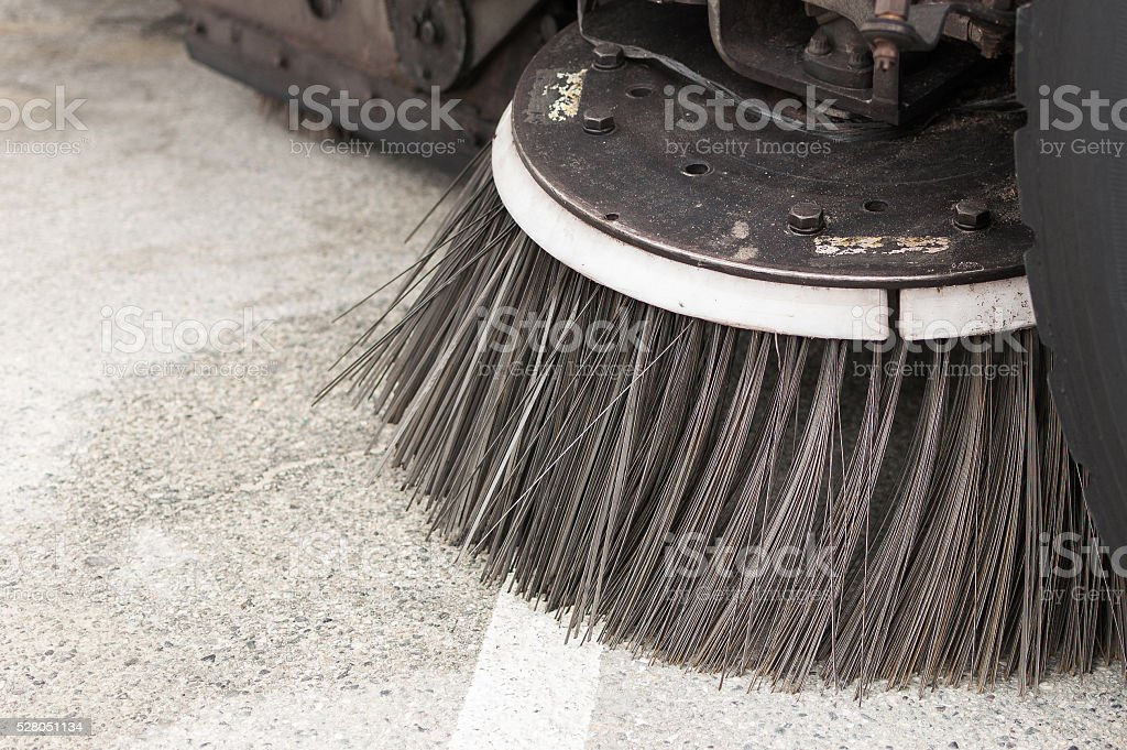 Close-up of a street sweeper vehicle's brush stock photo