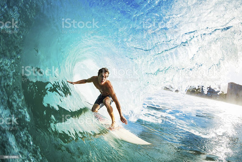 Close-up of a surfer riding a large blue wave stock photo