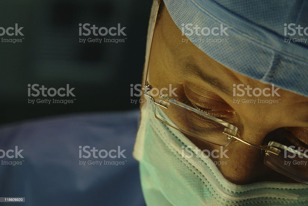 Close-up of a surgeon wearing mask and glasses royalty-free stock photo