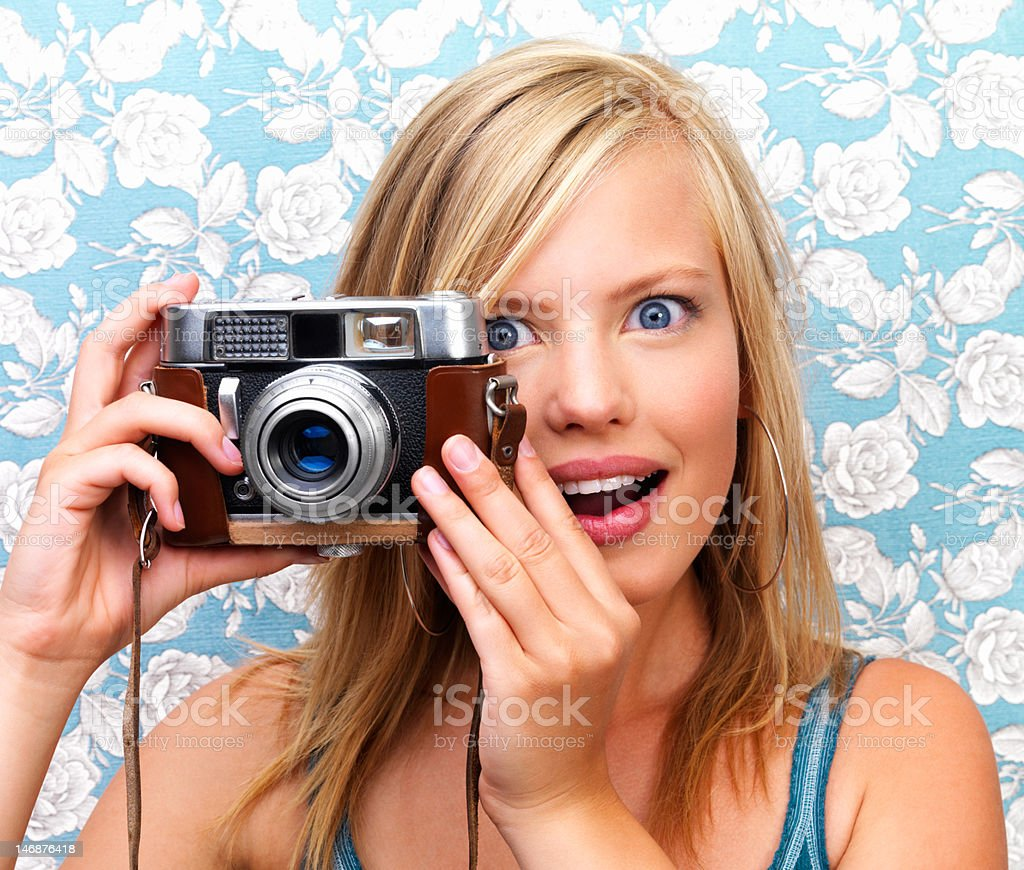 Close-up of a surprised teenage girl clicking camera royalty-free stock photo