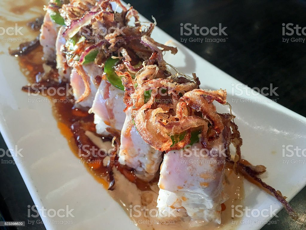 Close-up of a sushi roll on a plate stock photo