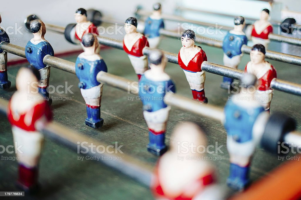 Close-up of a table soccer game in red and blue jerseys stock photo