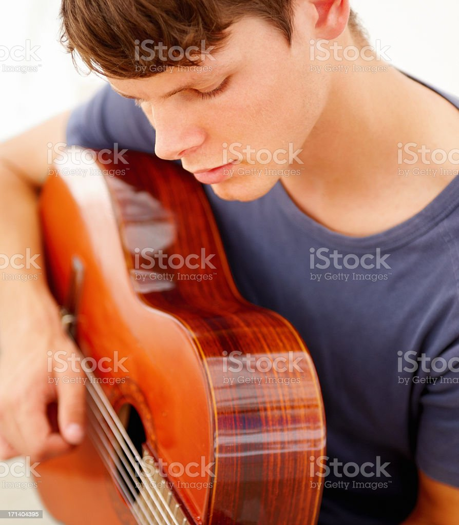 Closeup of a teen boy playing the guitar royalty-free stock photo