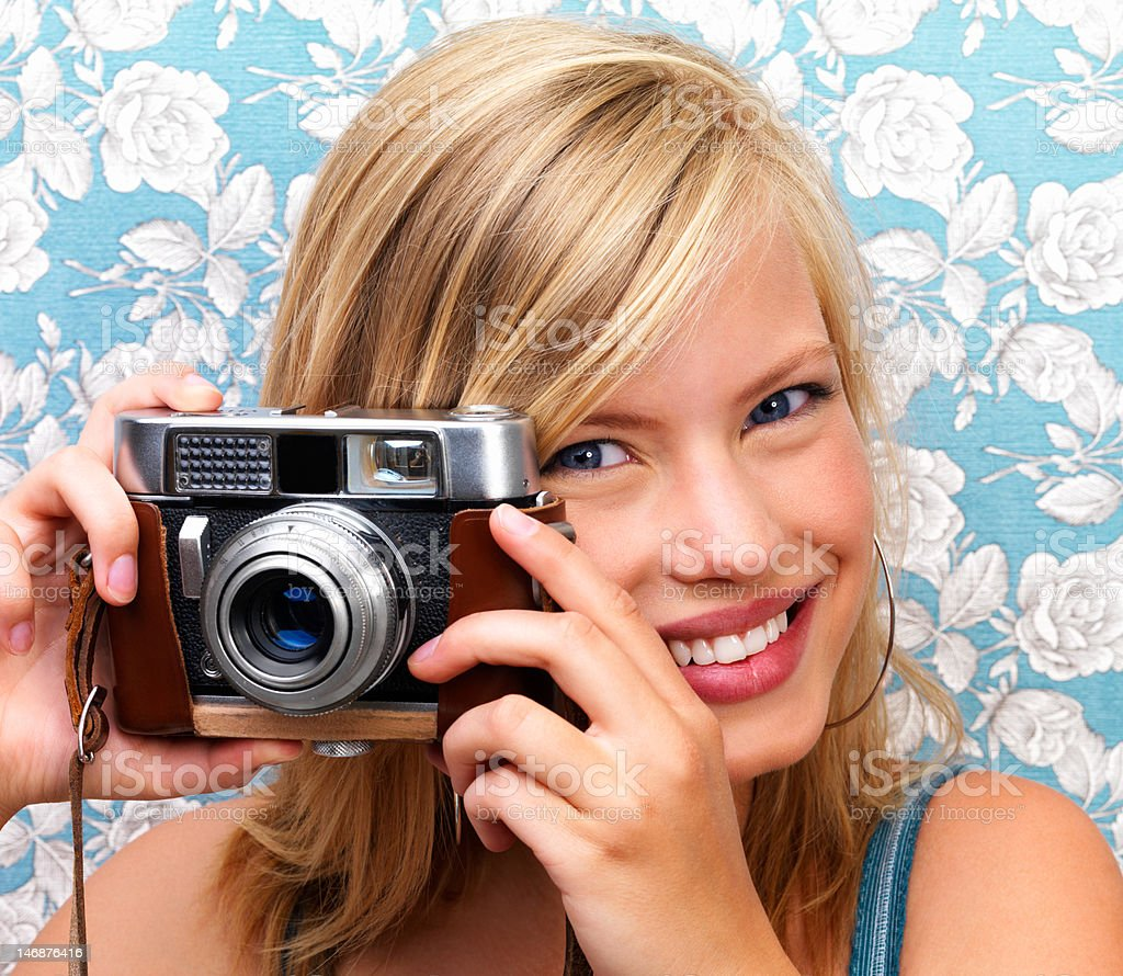 Close-up of a teenage girl holding camera royalty-free stock photo