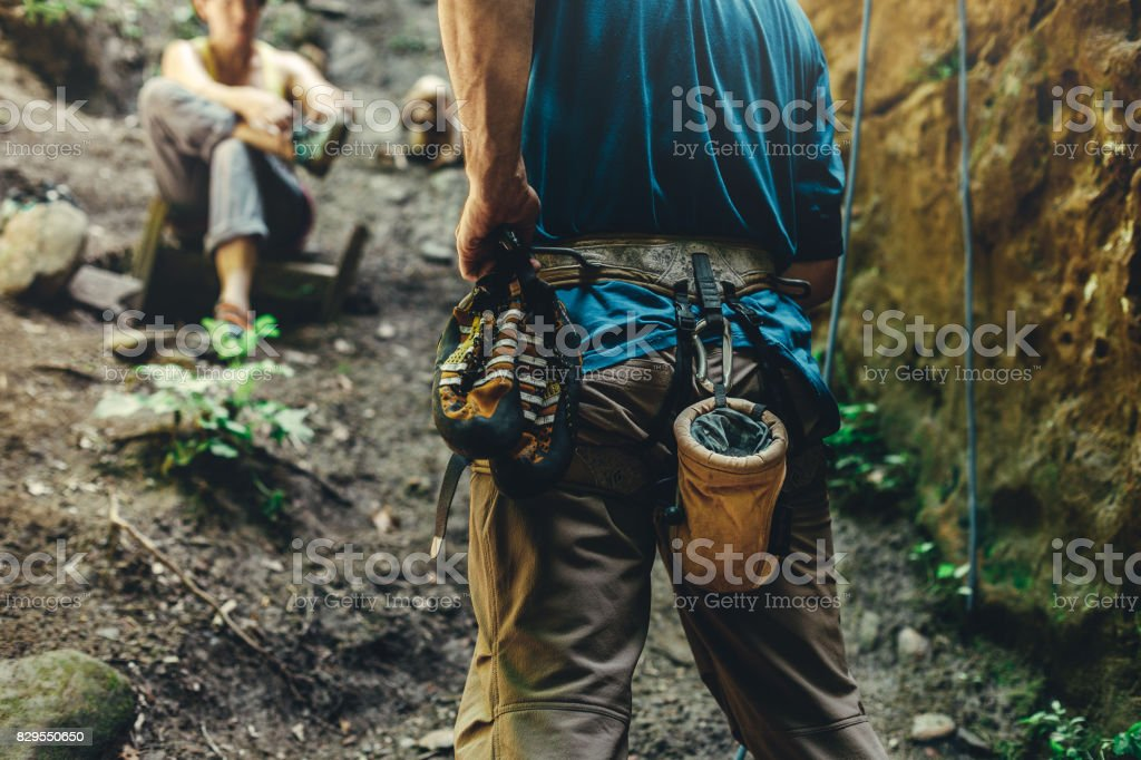 Close-Up Of A Thigh Climber With Equipment On A Belt, Stands On A Rock. Extreme Hobby Concept stock photo
