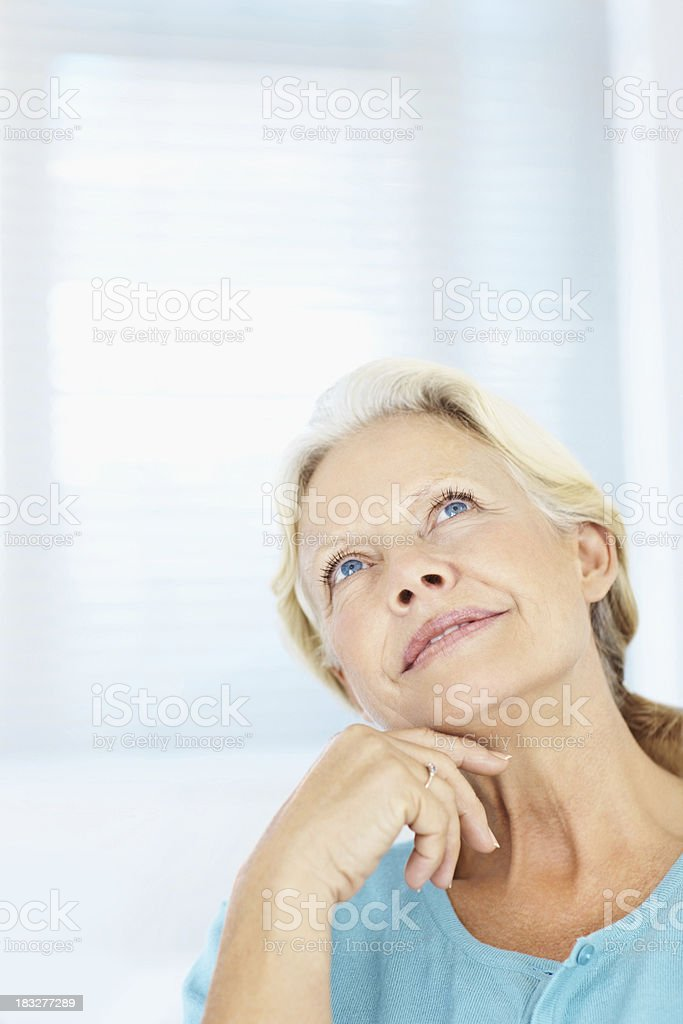 Closeup of a thoughtful senior lady looking up royalty-free stock photo