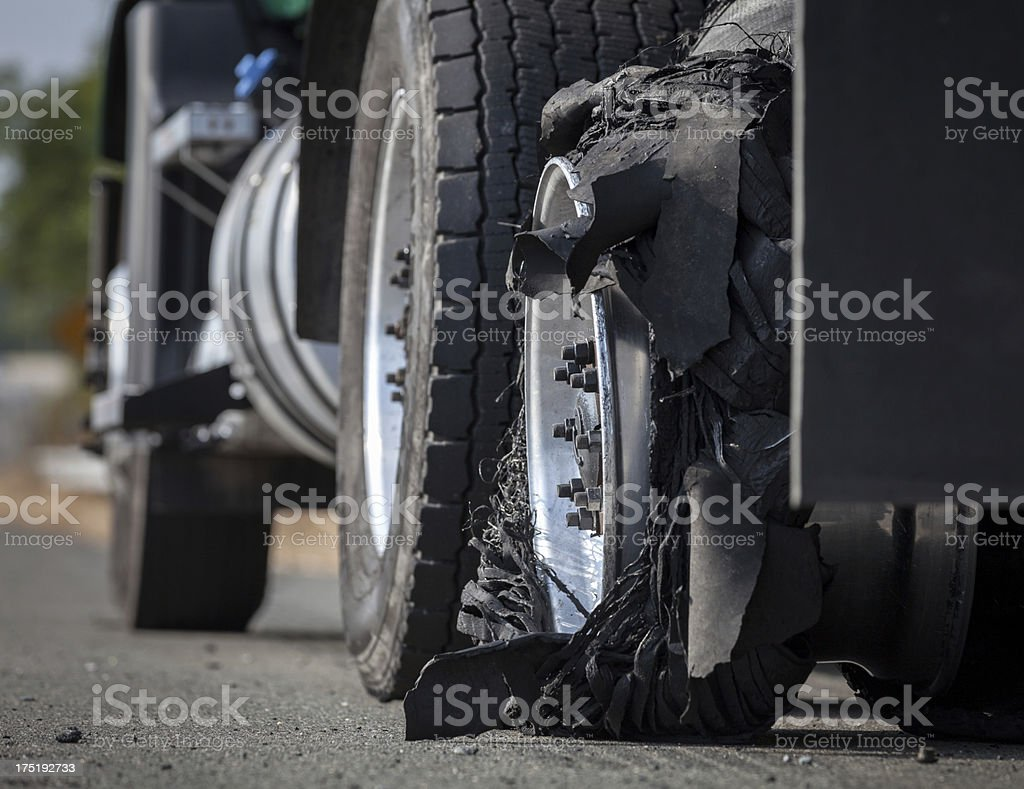 Closeup of a Tire Blowout on a Disabled Transportation Truck stock photo