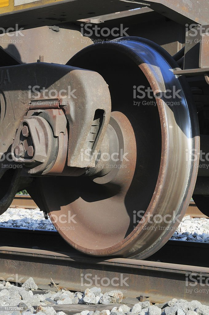 A close-up of a train wheel on a track stock photo