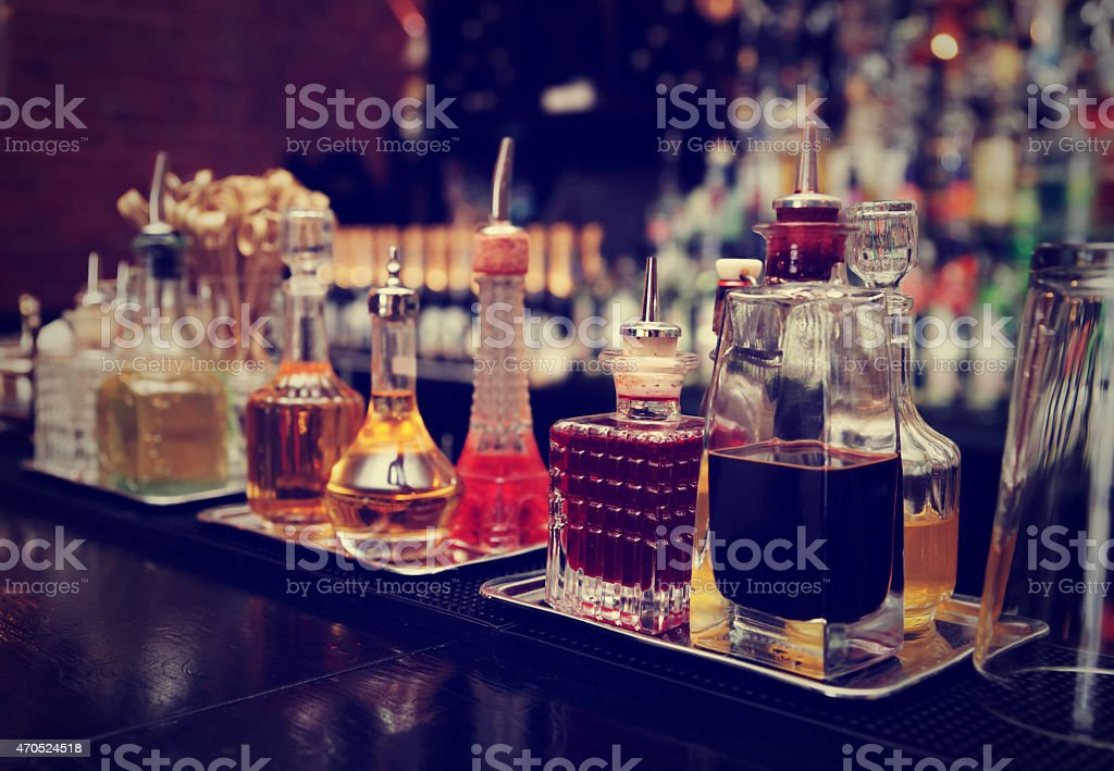 Close-up of a variety of liquor in glass bottles on counter stock photo