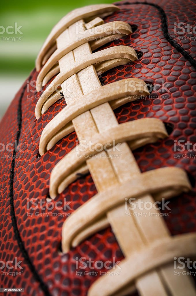 Closeup of a vintage american football ball stock photo