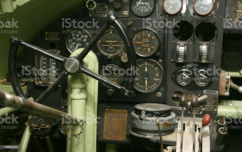 Closeup of a vintage cockpit with many gauges and levers. royalty-free stock photo