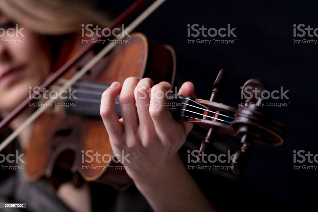 closeup of a violinist's hand playing stock photo