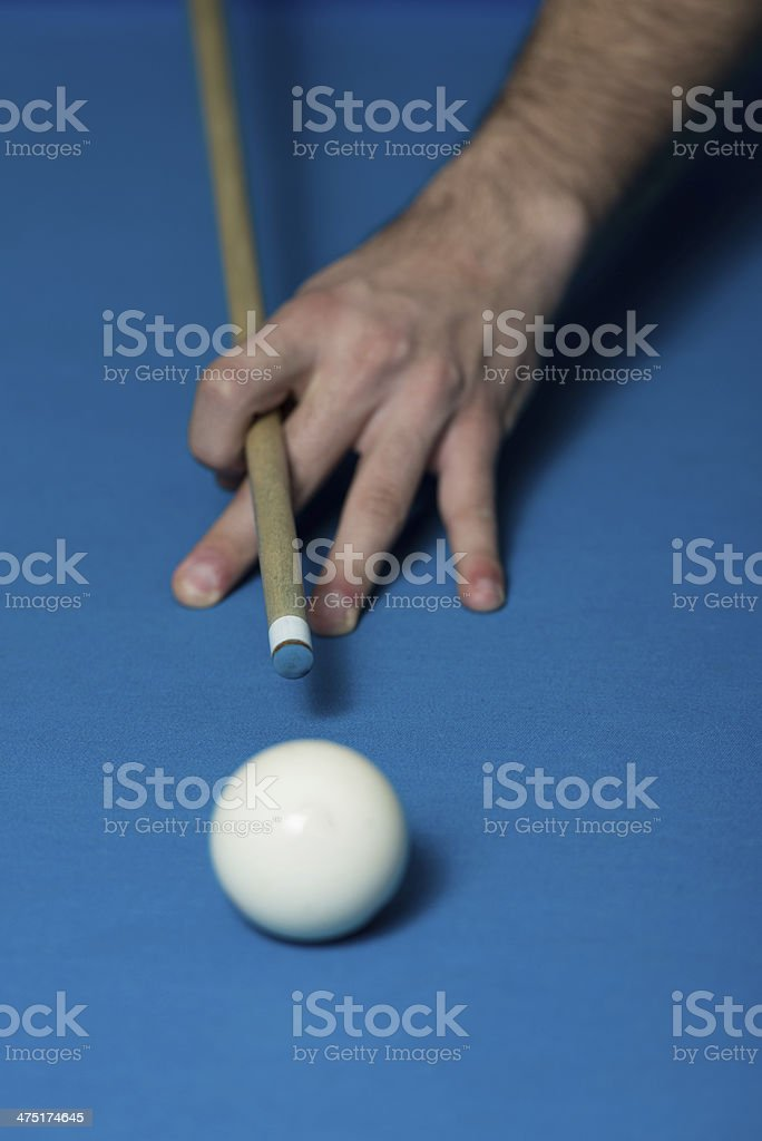 Close-Up Of A White Ball Waiting To Shoot stock photo