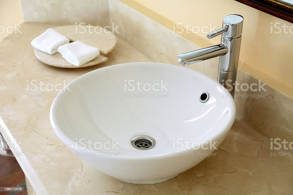 A close-up of a white circular sink in a bathroom royalty-free stock photo