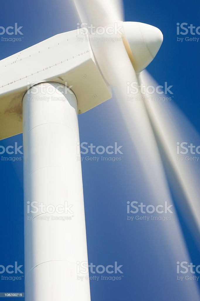 A close-up of a white windmill in motion royalty-free stock photo