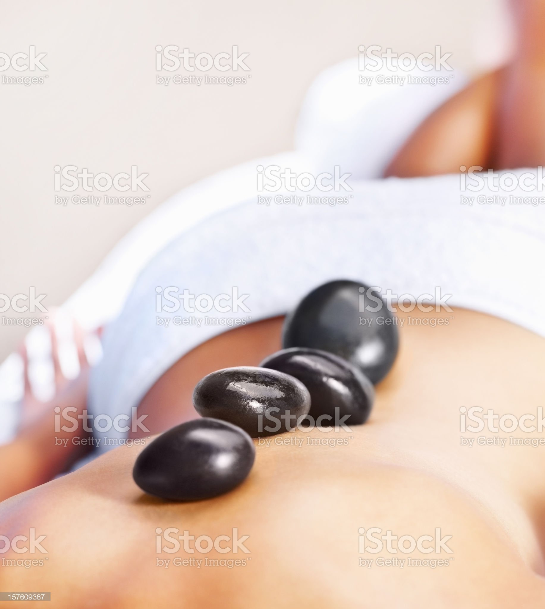Closeup of a woman at spa having hot stone treatment royalty-free stock photo