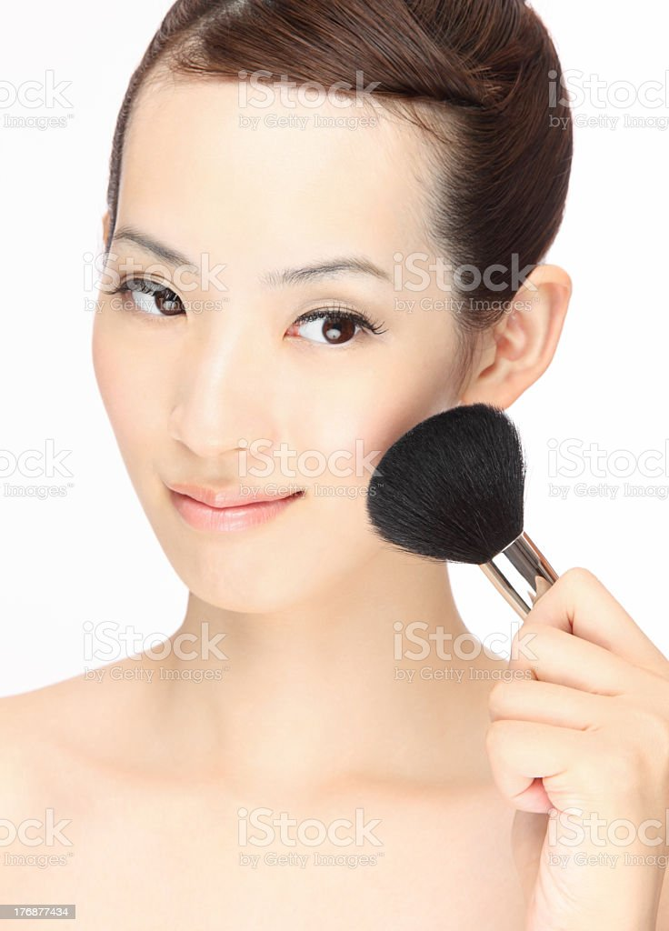 A close-up of a woman doing her makeup royalty-free stock photo