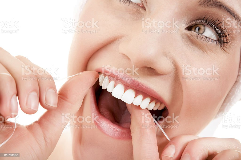 Close-up of a woman flossing royalty-free stock photo
