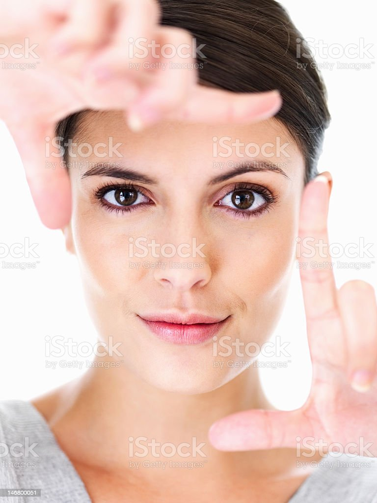 Closeup of a woman framing face within her fingers royalty-free stock photo