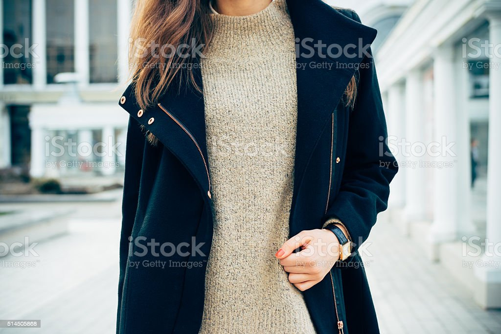 Close-up of a woman in a sweater, a coat stock photo
