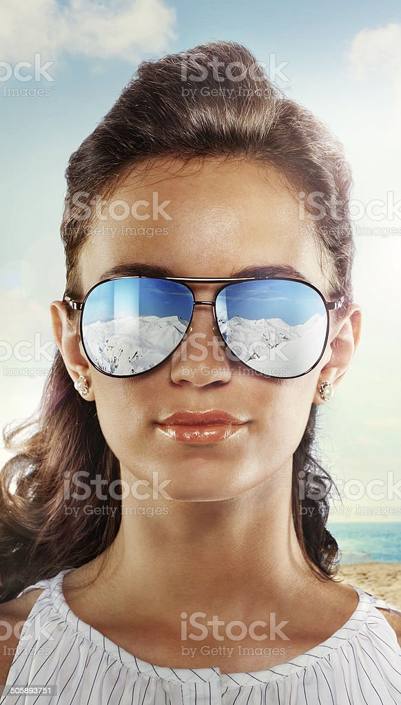 Close-up of a woman  on beach in the glasses stock photo