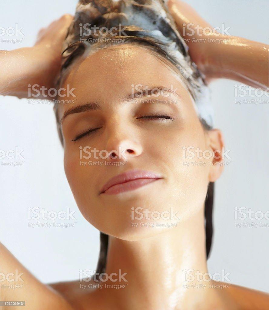 Close-up of a woman washing hair stock photo